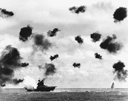 Yorktown at the moment of impact of a torpedo from a Nakajima B5N. Picture from Wikipedia.